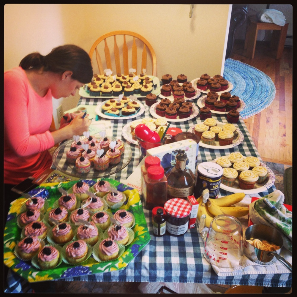 This is what a cupcake making factory the day of a wedding looks like. :)